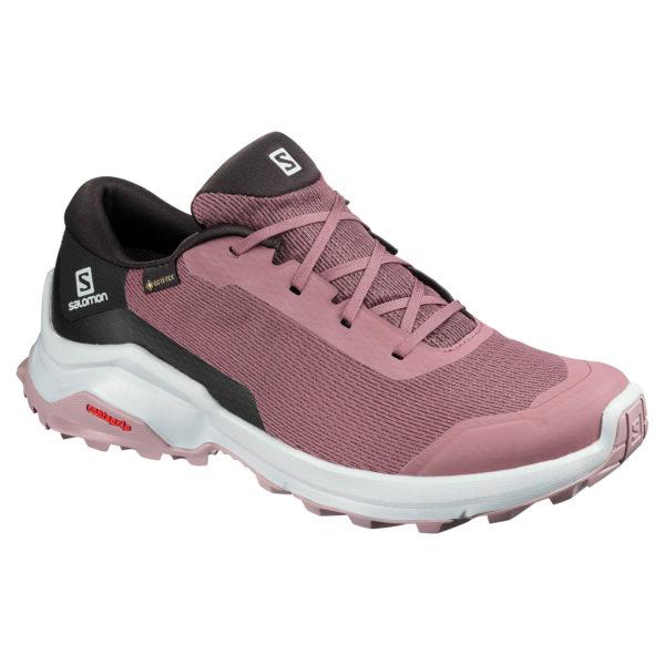 SALOMON REVEAL GTX som har ett modernt, sportigt utseende i färgerna rosa och svart.